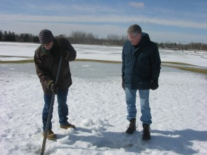 Dr. Ken Carey and Peter Purvis examining the ice layer