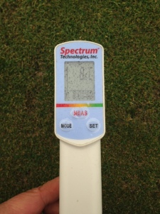 Soil temperature probe showing 8 degrees C at 3 cm